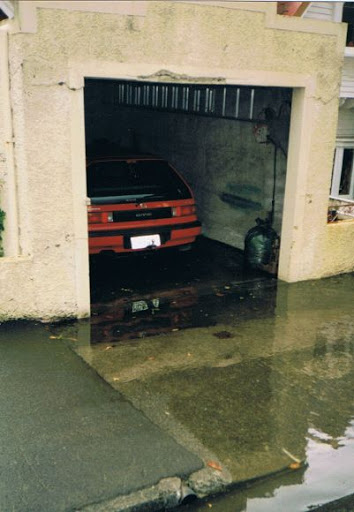 sensible repairs to garage on frontage - broken lintel, new floor to improve levels/prevent flooding